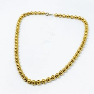 Vintage 18 inch long necklace in Gold Tone